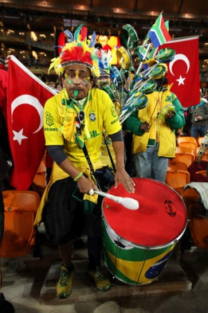 Passion: A Brazil fan at the 2010 FIFA World Cup match between Brazil and the Ivory Coast at Johannesburg.