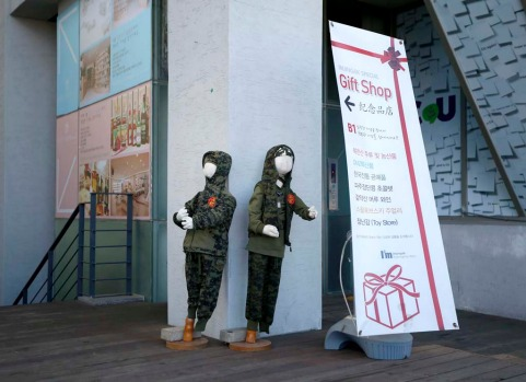 Military uniforms for children are displayed at the Imjingak pavilion near the demilitarized zone which separates the ...