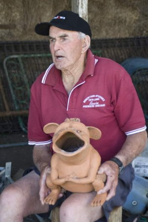 "Dairy farmer Ken Sharpe with his ceramic ""bunyip""."