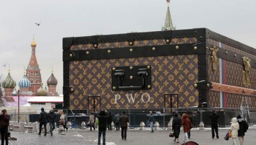 People walk past a Louis Vuitton pavilion which is in the shape of a giant suitcase in central Moscow.