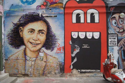 An artwork (left) created by Australian Jimmy C outside Berlin's Anne Frank Museum.