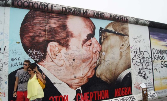 The famous kiss painting on the East Side Gallery is one of the most popular works on the Berlin Wall. It features East ...