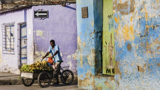 A fruit seller on Cartagena's colourful streets in Colombia.