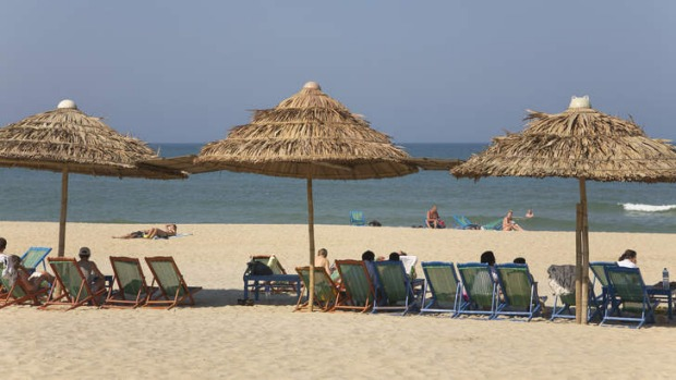 Fly and flop: holidaymakers on Cua Dai Beach.