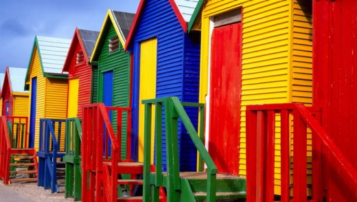 Fish Hoek: colourful old seaside chalets near the city.