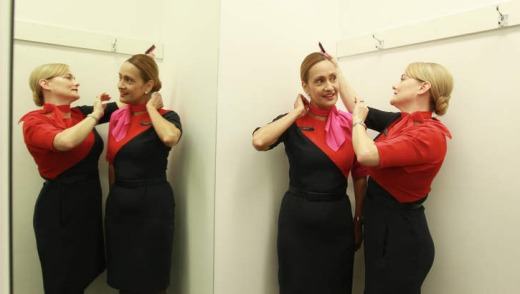 Qantas employees Sharon Ashcroft and Albertina Hill wearing their new uniforms.