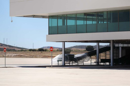 A baggage ramp at the terminal building of Cuidad Real International Airport stands dormant.