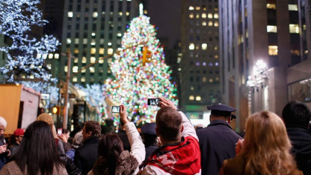 Spectators enjoy the celebration during 81st Annual The Rockefeller Centre Christmas tree lighting ceremony at ...