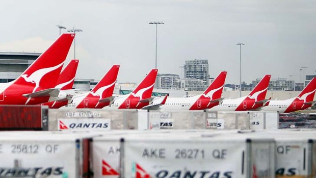 Qantas airplanes lined up at Sydney airport in October 2011, after Qantas grounded its entire fleet as a result of ...