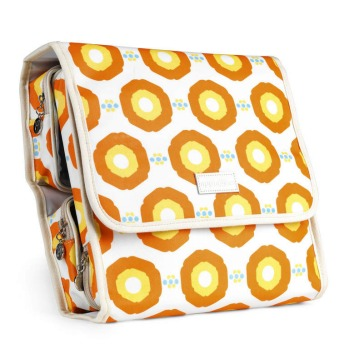 Carry-all traveller toiletry case by Apple & Bee, sunflower orange, $69.95, appleandbeeshop.com.
