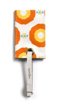Luggage tags by Apple & Bee, sunflower orange, $16.95, appleandbeeshop.com.