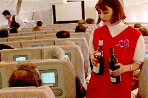 Alcohol being served on plane by flight attendant