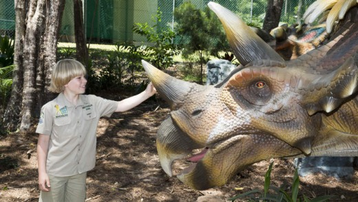 Robert Irwin  with a triceratops at Palmersaurus.