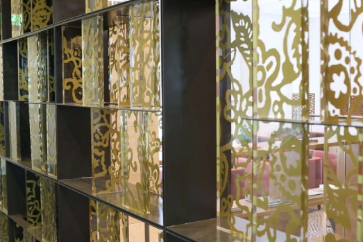 The 'home' concept includes a customised batik screen in the welcome foyer.