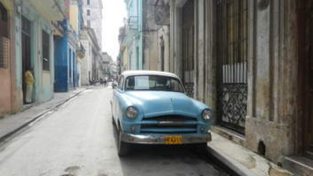 A street in Havan, with one of the city's iconic blue cars.