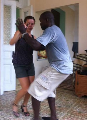 Expert instruction: Larissa Ham dances with doctor-turned-tutor Leonardo, in Havana.