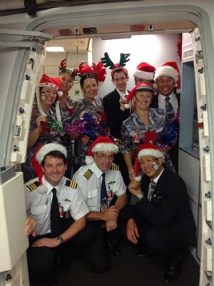 Qantas staff will be getting into the festival spirit with passengers flying on Christmas Day.