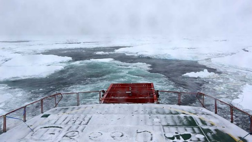 All white: A view from the stern of the  Aurora Australis as it punches its way through sea ice towards the Akademik ...