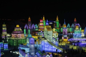 Visitors look at ice sculptures during a light-up rehearsal ahead of the Harbin Ice and Snow Sculpture Festival in the northern city of Harbin, Heilongjiang province.