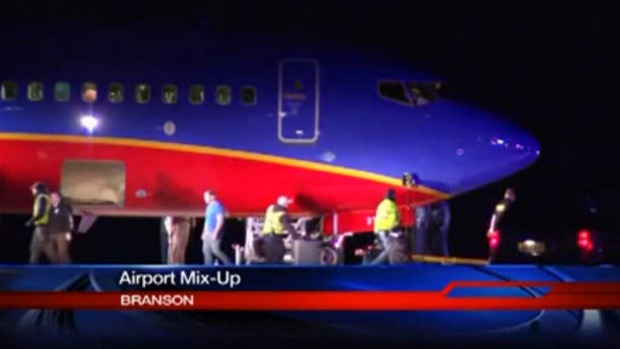 Stopped at end of wrong runway ... This frame grab provided by KSPR-TV shows a Southwest Airlines flight at an airport ...