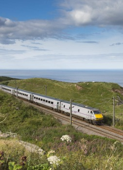 A train rumbles along the east coast of Britain