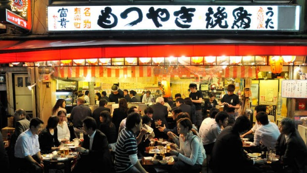 A restaurant under the train tracks at Ginza.