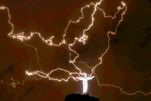 A lightning flashes over the statue of Christ the Redeemer on January 16.