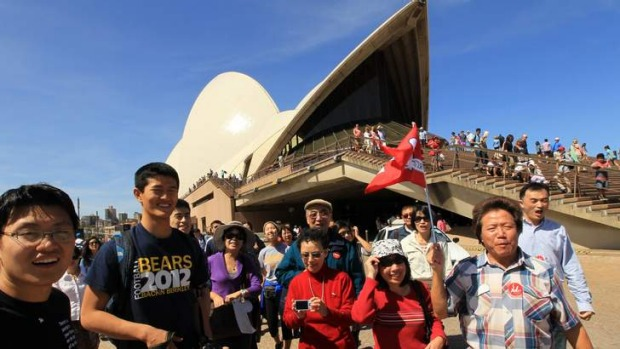 A group of Chinese tourists at the Sydney Opera House.