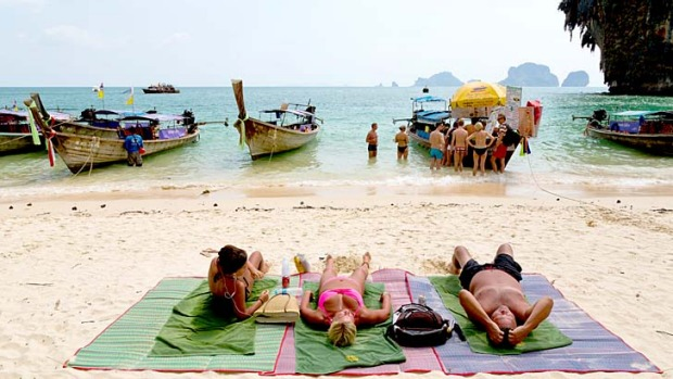 Tourists are flocking to Thailand's beach resorts as they avoid the political turmoil in Bangkok.