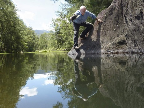 John Reid searches for the Fishman in the Deua River, but finds only his own reflection.