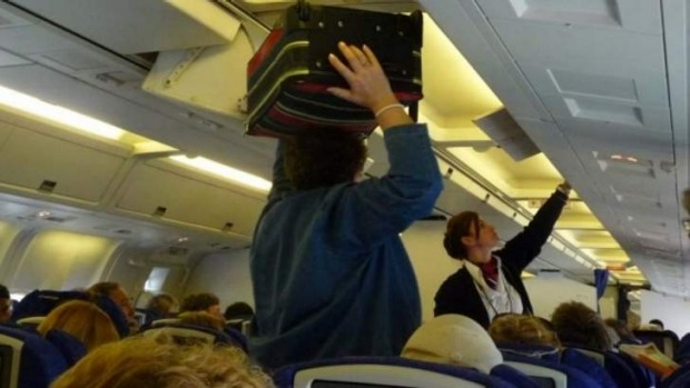 A quicker way to get passengers on a plane is to have them board based on their carry-on luggage, a study has found.