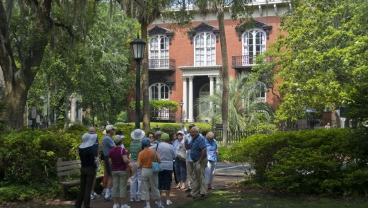 Tourists gather outside Mercer-Williams House in Savannah.