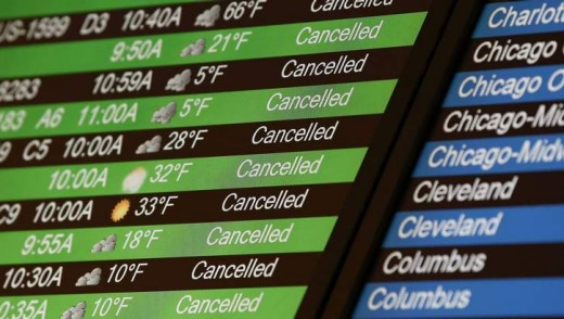 Flight cancellations on the board at LaGuardia Airport in New York.