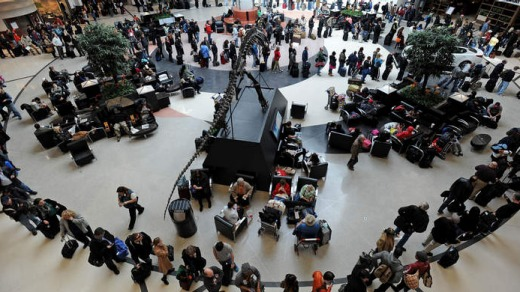 A long line of travellers winds around the atrium at Hartsfield-Jackson International Airport, the busiest airport in ...