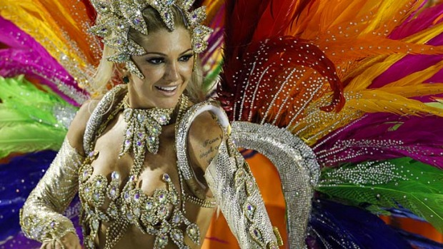 A dancer from Mocidade samba school parades during Carnival celebrations.