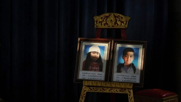 Portraits of  blast victims Patcharakorn Yosubon and her brother Koravitch Yosubonis placed at a Buddhist temple for last rites in Bangkok.