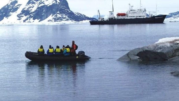 Raw beauty: a Zodiac with the Polar Pioneer in the background.