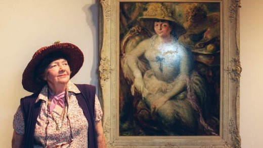 Olley with William Dobell's portrait of her.