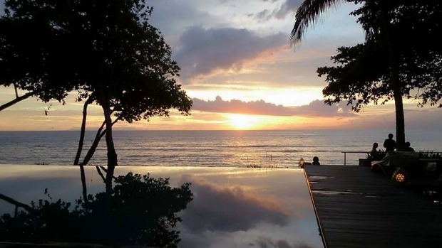LOMBOK, BALI. The beach in front of Jeeva Klui Resort looks west across the Lombok Strait to Bali, and it's a sunset ...