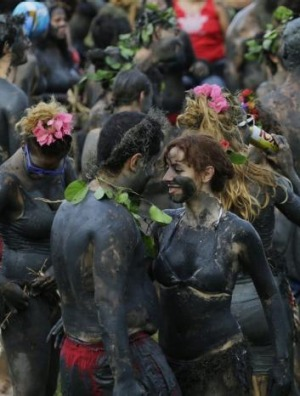 Mud-covered revellers dance during the Bloco da Lama or 'mud street partyÃ?Â?' in Paraty, Brazil.