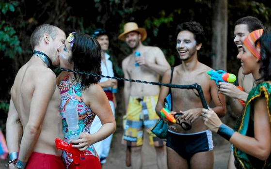A man, in a leash, kisses a reveler at the Carmelitas block party during Carnival celebrations in Rio.