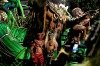 Revellers of the Imperio da Tijuca samba school have their picture taken in front of a float outside the Sambadrome ...