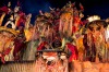 Members of Imperio da Tijuca Samba School celebrate during the closing parade of the day at 2014 Brazilian Carnival at ...