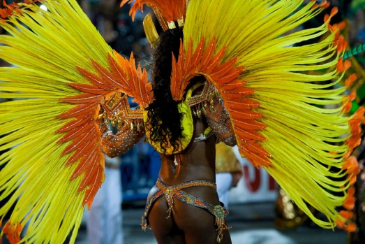 Member of Imperio da Tijuca Samba School celebrate during the closing parade of the day at 2014 Brazilian Carnival at ...