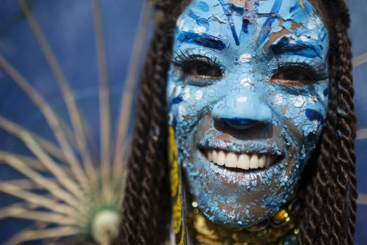 A reveller dressed as a character from the movie Avatar poses for a photo at the 'Ceu na Terra' block party during ...