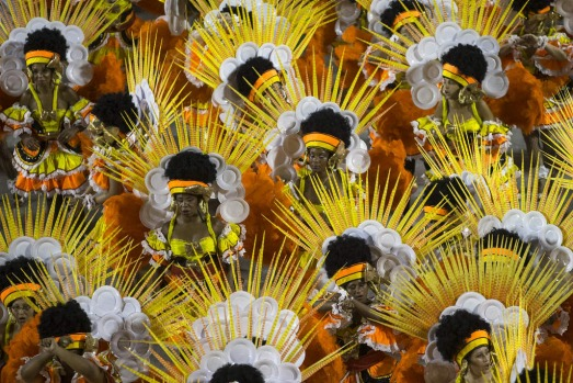 Performers from the Sao Clemente samba school parade during carnival celebrations at the Sambadrome in Rio de Janeiro, ...
