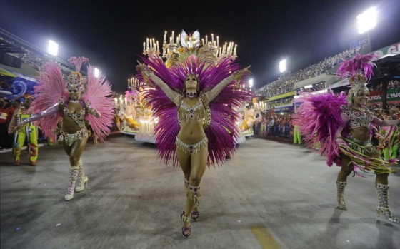 Performers from the Mangueira samba school parade during carnival celebrations at the Sambadrome in Rio de Janeiro.