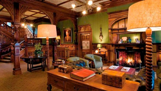 The warm and welcoming Otahuna Lodge lobby at Tai Tapu is filled with antiques.