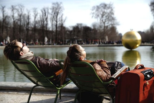 Visitors sunbathe in the Tuileries garden in Paris.
