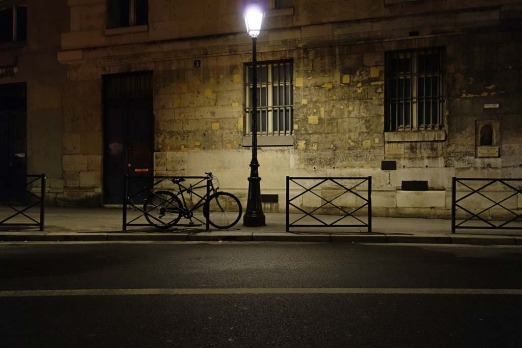 Paris on a winter's evening on Rue Mazarin, Paris.